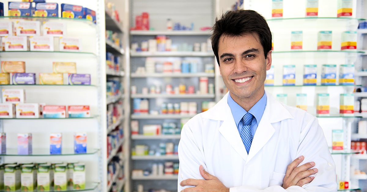 pharmacist in front of stocked shelves