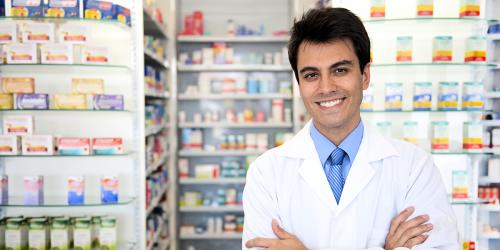 pharmacist in front of stocked shelves
